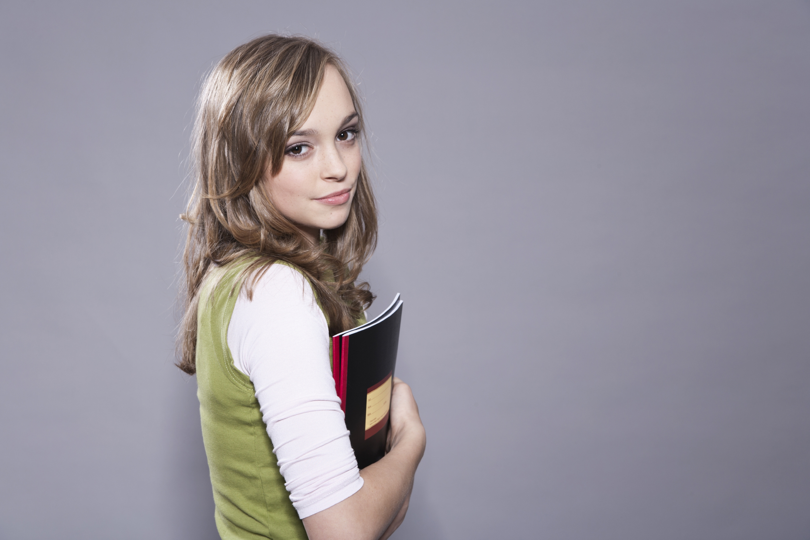 Teenage Girl Holding Books -iStock_000055507686_Large