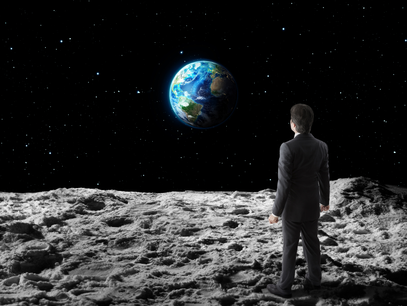 Business man on the moon iStock_000057326888_Small