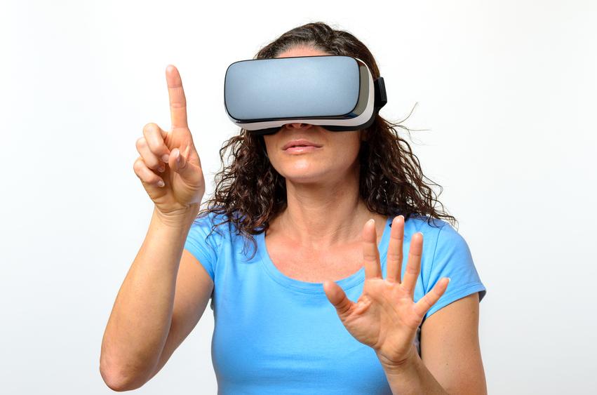 Woman experiencing a virtual environment