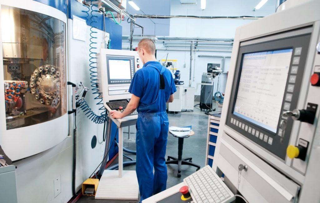 Man using Manufacturing Equipment